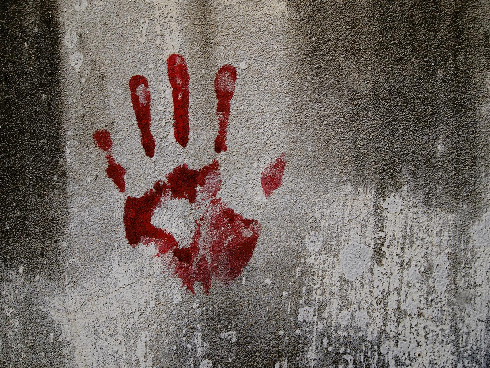bloody hand on wall